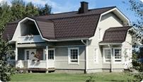Дом с ломанной крышей мансарды