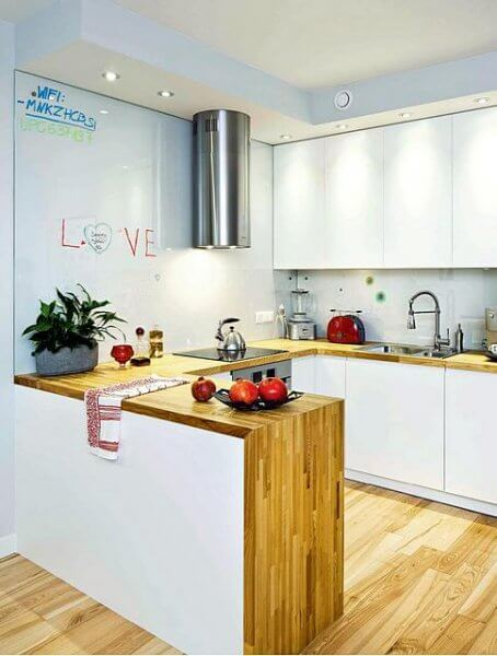 Интерьер открытой кухни студии в квартире